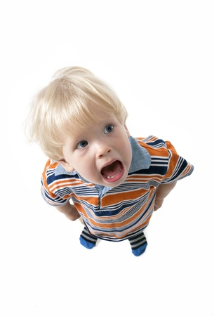 Adorable  blonde hair baby boy screaming and crying  photo