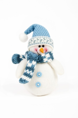 Snowman wearing  hat and scarf  photo