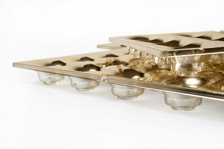 molded: empty golden box of chocolates shapes