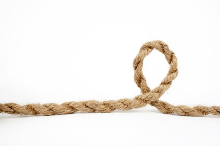 rope knot: close up of rope part with a loop, on white background  Stock Photo