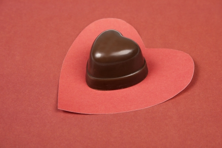 Heart from paper and heart shape chocolate  Valentine photo