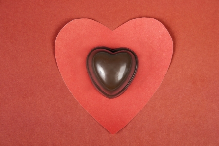 Heart from paper and heart shape chocolate  Valentine Stock Photo - 17558977
