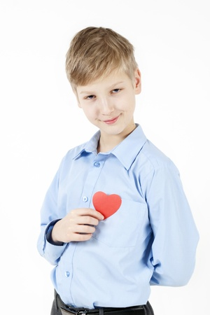 Smiling schoolboy and red heart  photo