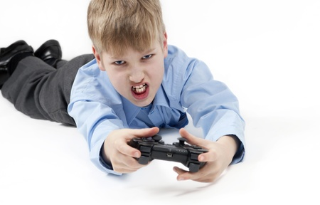 computer games: Boy playing a computer games  Stock Photo