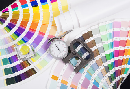 Lens, pantone and micrometer  Design and prepress concept