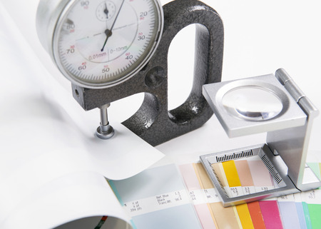 Lens, pantone and micrometer  Design and prepress concept photo