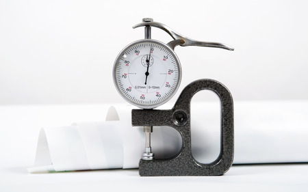 micrometer: Micrometer with the round white dial Stock Photo