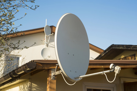 parabolic: TV - receiver on the roof of house  Stock Photo