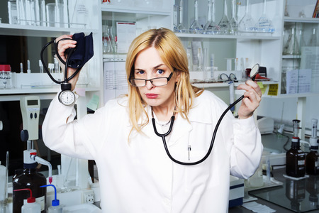 Expressive woman medical student in laboratory photo