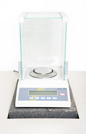 Laboratory scale on table white background