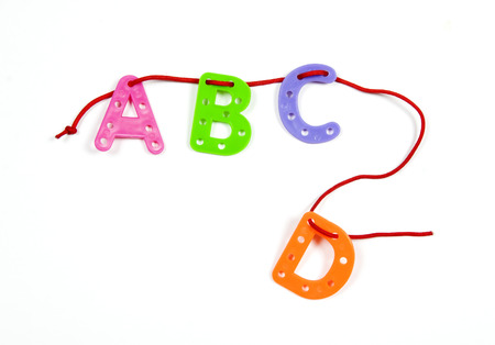 ABCD from color plastic on a cord Stock Photo