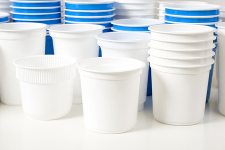 out of production: Empty white and blue food glasses