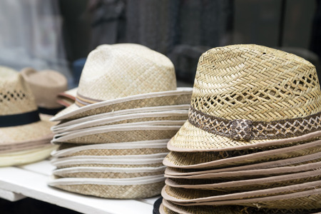 bast: Background of hats in street shop Stock Photo