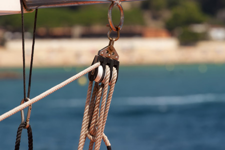 constrain: Holder of a rope on the sea boat Stock Photo