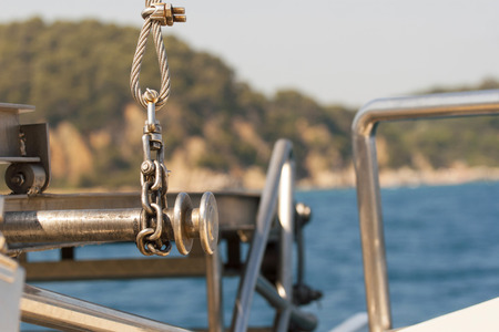 constrain: Detail of fastening of a cable on the sea boat.