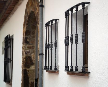 iron barred: Metal vintage bars on the windows