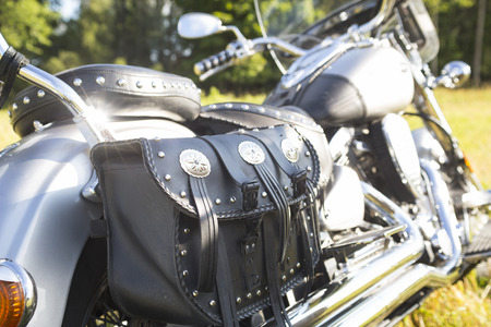Rear part of motorcycle. Black leather bag. Standard-Bild