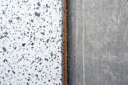 polyurethane: Polyurethane insulation foam between polystyrene foam concrete wall. Foam black and white background.