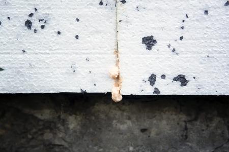 concrete: Polyurethane insulation foam between polystyrene foam. Foam black and white background. Stock Photo