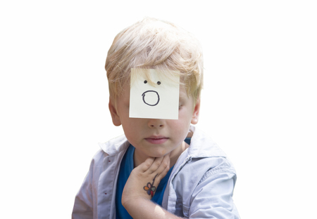 gasp: On the forehead shows (drawn) gasp icon on yellow stickers. Concept of surprise thoughts and positive emotions. Surprising boy isolated on white background. Stock Photo