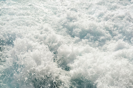 sea water: Turbulent chaotic white spray of sea foam and blue sea salt water as a background, top view, horizontal. Stock Photo