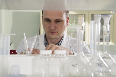 white work: scientist in laboratory work with test-tube white Stock Photo