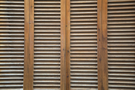 jalousie: Brown, wooden, vertical completely covered blinds as a background. Horizontal top view shot with space for text. Stock Photo