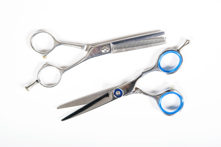 haircuts: Professional scissors for haircuts isolated on white background