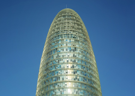 'phallic symbol': Architectural detail of the Agbar Tower, Torre Agbar, located in the Poblenou neighborhood of Barcelona, SPAIN, against blue sky Stock Photo