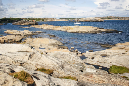 the end: Idyllic view of beautiful rock on the sea. Verdens Ende, Worlds End, or The End of the Earth is located at the southernmost tip of the island of Tjome in Vestfold, Norway. Stock Photo