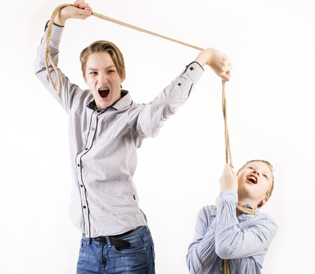 vengeance: Young boy chocking another boy with a rope isolated on white background.