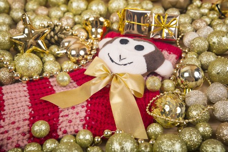 next year: Any nice golden and red christmas balls with monkey, next year symbol on red sox like a christmas background. Stock Photo