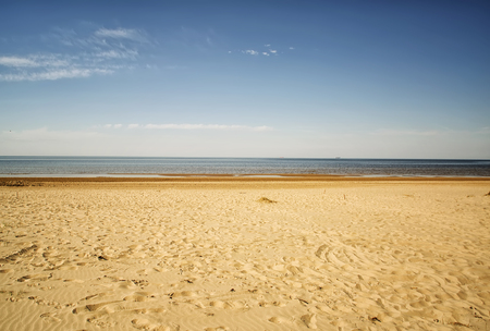jurmala: Cool lonely ambient sea sand beach with blue sky in Jurmala, Latvia.