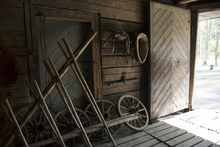 hayloft: Old tools stored in the barn. Interior of a wooden hayloft. Stock Photo