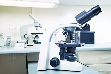 eyepiece: Photo of a professional ocular laboratory microscope with stereo eyepiece in laboratory interior.