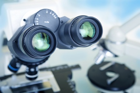 an eyepiece: Professional ocular laboratory microscope with stereo eyepiece close-up. Stock Photo