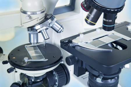 eyepiece: Professional ocular laboratory microscope with stereo eyepiece close-up. Stock Photo