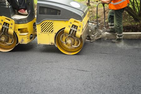 compaction: Road roller flattening new asphalt. Compaction works