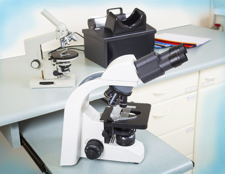 an eyepiece: Photo of a professional ocular laboratory microscope with stereo eyepiece in laboratory interior.