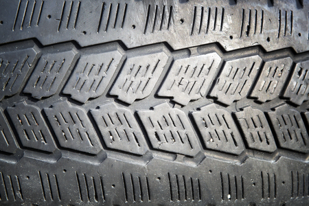 erased: Erased automobile tires background. Structure of a tread of rubber.