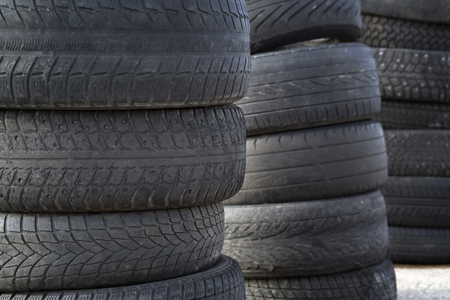 dump yard: Erased automobile tires background. Structure of a tread of rubber.