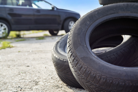 heaped: Old erased tires heaped on concrete plates