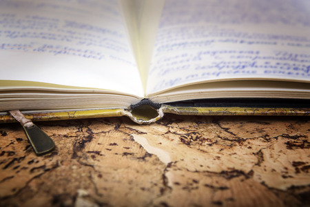 antiquarian: Ancient notebook with records on an old  background. Antiquarian books.