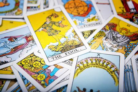 cartomancy: Tarot cards mystical old  background. Senior card fool. Stock Photo