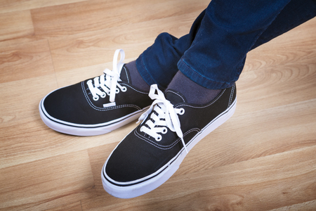 Black sports shoes. Modern teenage footwear.