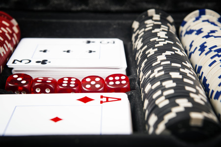 gambling counter: Poker cards and gambling chips background. Cards concept. Stock Photo