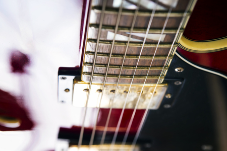 Red acoustic guitar close up in dark background Stock Photo