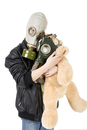 gasmask: Child with a toy in a gas mask