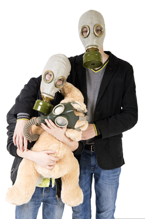 Children in a gas mask with a toy Foto de archivo