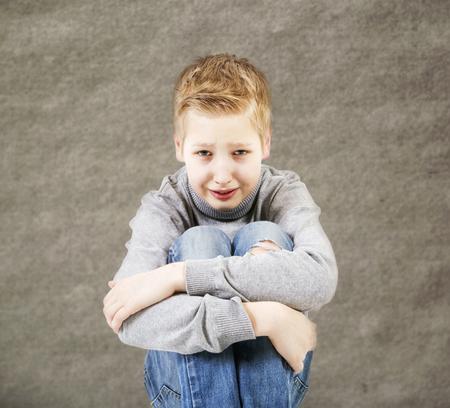 sulk: sad boy Stock Photo